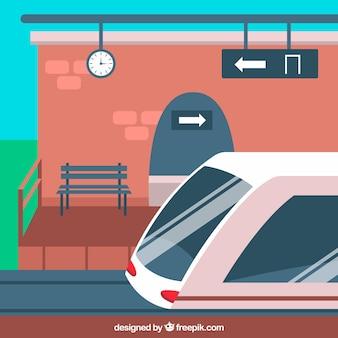 Gare ferroviaire avec banc et train