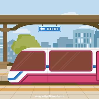 Gare ferroviaire avec fond de bâtiments