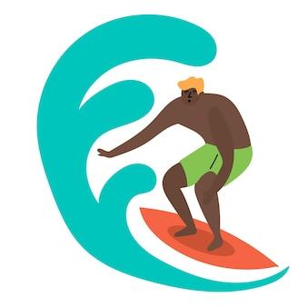Un gars a attrapé une vague qui roule une planche de surf surfant sur l'océan