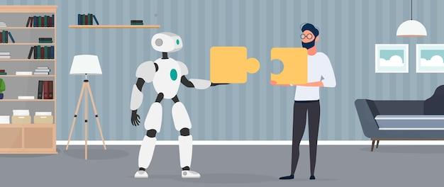 Le gars et le robot tiennent des pièces de puzzle. notion de travail d'équipe.