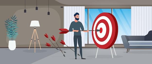 Le gars tient une flèche. la flèche atteint la cible. le concept d'entreprise prospère, de travail d'équipe et d'atteinte des objectifs. vecteur.