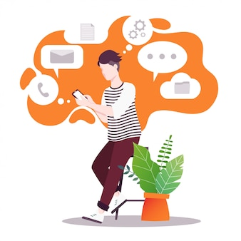 Le gars tient le téléphone dans ses mains. la polyvalence de la technologie moderne.