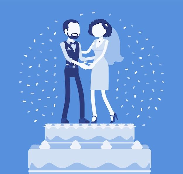 Gâteau glacé riche de mariage avec les mariés sur le dessus