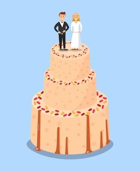 Gâteau de mariage avec des affiches de chapeaux de jeunes mariés.