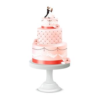 Gâteau de mariage avec statuette de jeunes mariés