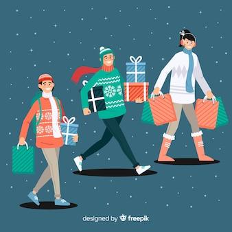Les gens achètent des cadeaux de noël