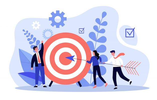 Les gens d'affaires conduisant la flèche vers l'objectif