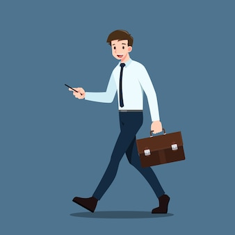 Les gens d'affaires détenant un téléphone portable et à pied pour travailler.