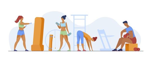 Gens dans le club de fitness