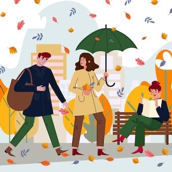 Gens dans le parc d'automne
