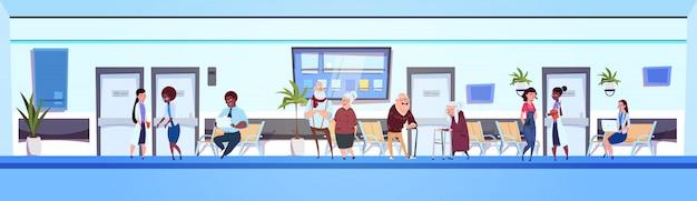 Gens dans la salle d'hôpital patients et médecins équipe de la salle d'attente de la clinique bannière horizontale