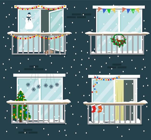 Les gens décorent la maison et les balcons pour noël. hiver, neige, sapin de noël, guirlandes.