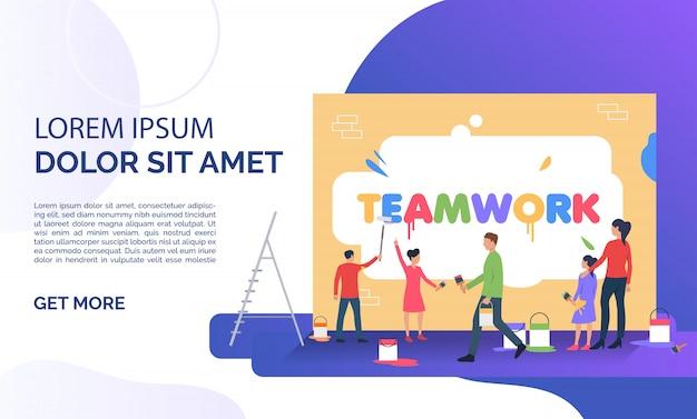 Gens écrivant le mot travail d'équipe sur le mur et exemple de texte