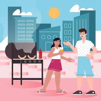 Gens faisant un barbecue sur la terrasse sur le toit