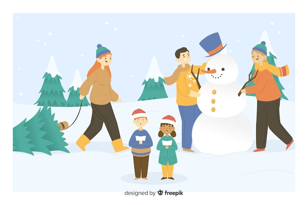 Gens faisant une fête de noël bonhomme de neige
