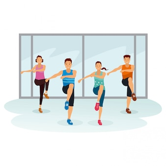 Les gens font de l'exercice ensemble dans la salle de gymnastique
