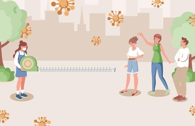 Les gens gardent une distance sociale sûre dans le parc de la ville