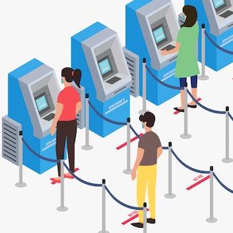 Les gens gardent leurs distances tout en faisant la queue au guichet automatique