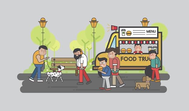 Des gens heureux dans un camion de nourriture