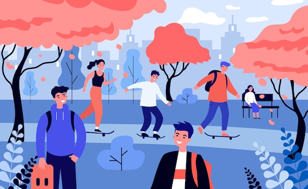 Les gens heureux patinent dans le parc de l'automne.