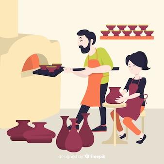 Des gens à la maison font de la poterie
