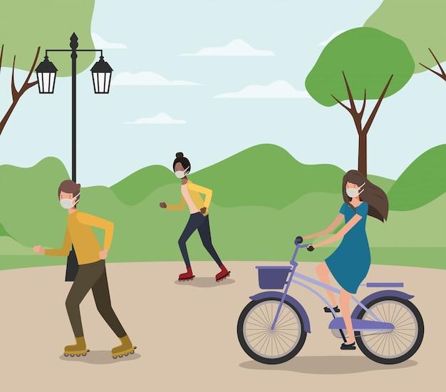 Gens avec des masques sur vélo et patins à roulettes au parc
