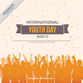 Les gens orange silhouettes fond de la journée de la jeunesse