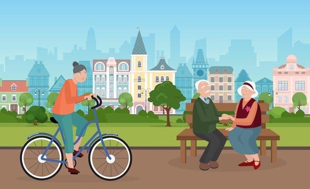 Les gens passent du temps dans le paysage urbain du parc de la ville avec un couple de personnes âgées assis sur un banc ensemble