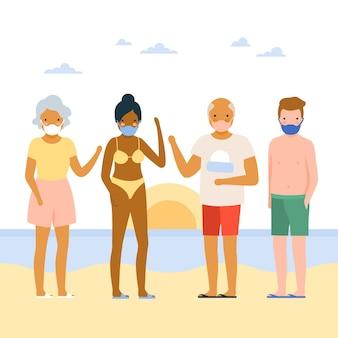Les gens sur la plage portant des masques