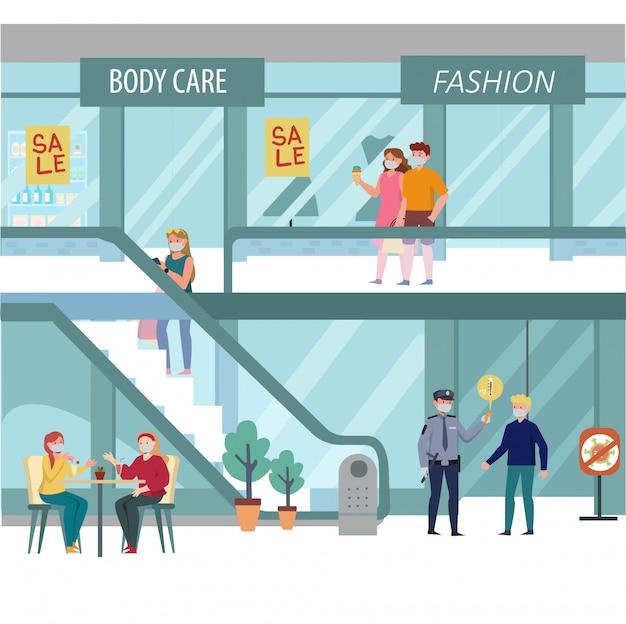 Les gens profitent de leur temps au centre commercial tout en gardant leurs distances les uns avec les autres