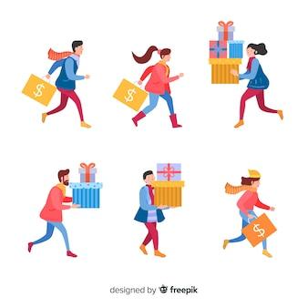 Gens qui achètent une collection de cadeaux de noël