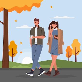 Les gens qui marchent en automne
