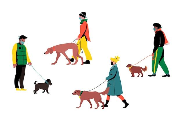 Les gens qui marchent avec leurs chiens mignons