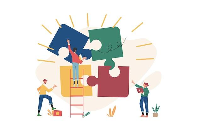 Les gens qui travaillent en équipe construisent des éléments commerciaux de puzzle