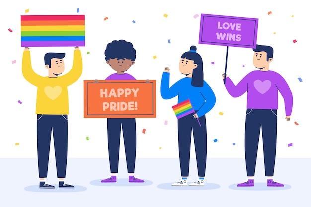 Les gens avec des signes de symbole de fierté