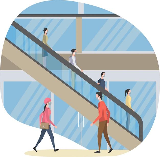 Les gens utilisent l'escalator dans le centre commercial tout en gardant leur illustration de distance
