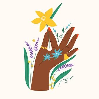 Geste avec des fleurs et des feuilles composition à plat tendance avec main tenant un narcisse