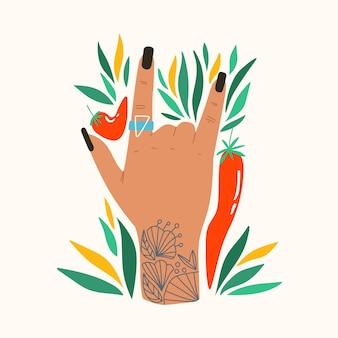Geste avec des fleurs et des feuilles composition plate tendance avec main rock and roll avec tatouage