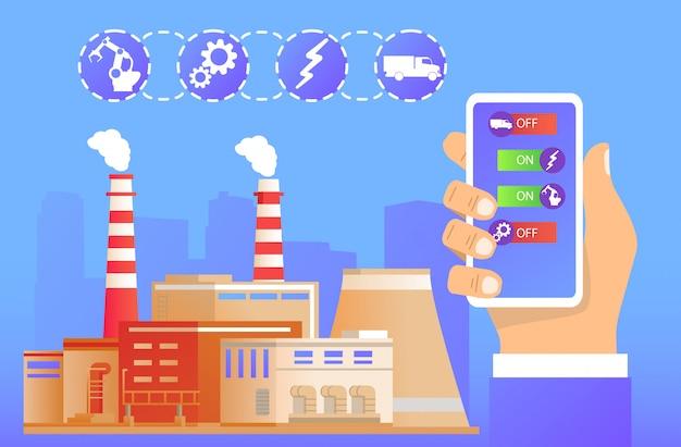 Gestion d'usine à distance.industrie intelligente.la main tient le smartphone sur l'application bâtiment industriel.