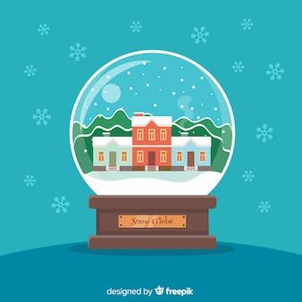 Globe boule de neige avec un design de noël dans un style plat