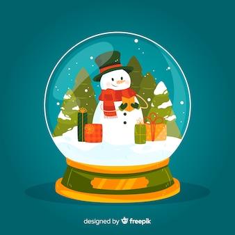 Globe boule de neige de noël dessiné main avec bonhomme de neige