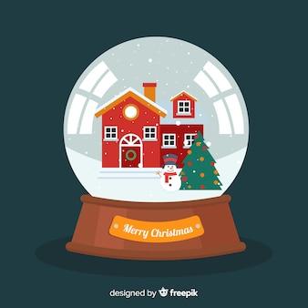 Globe boule de neige plat de noël avec maison