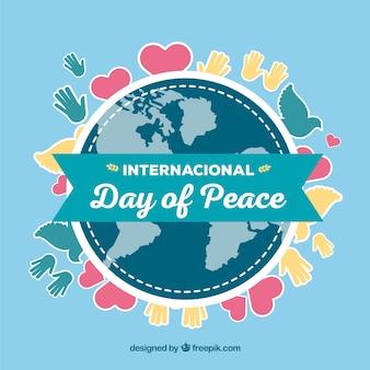 Globe mondial, ruban et dessins de la paix
