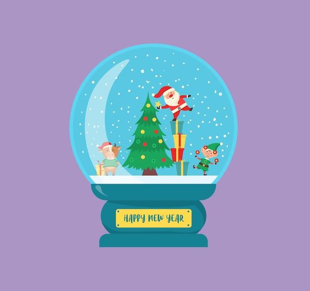 Globe de souvenir de boule de verre de noël avec la petite ville en caractères d'hiver à l'intérieur d'un globe de neige