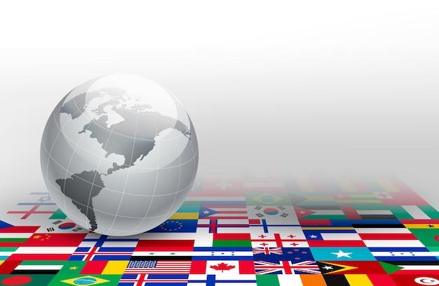 Globe terrestre sur fond de drapeaux.