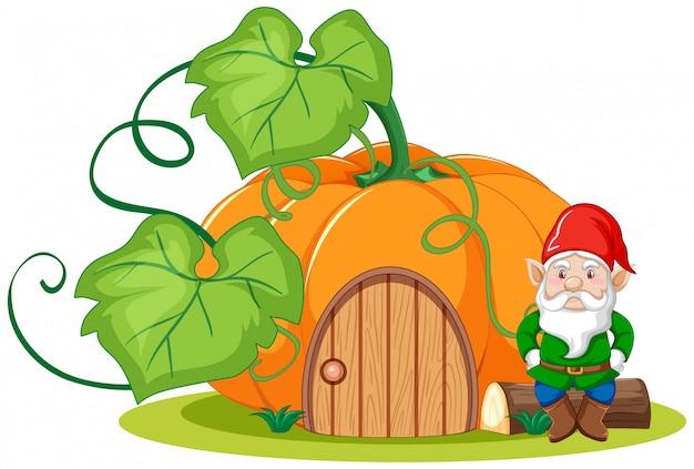 Gnome assis à côté du style de dessin animé de la maison de citrouille sur fond blanc