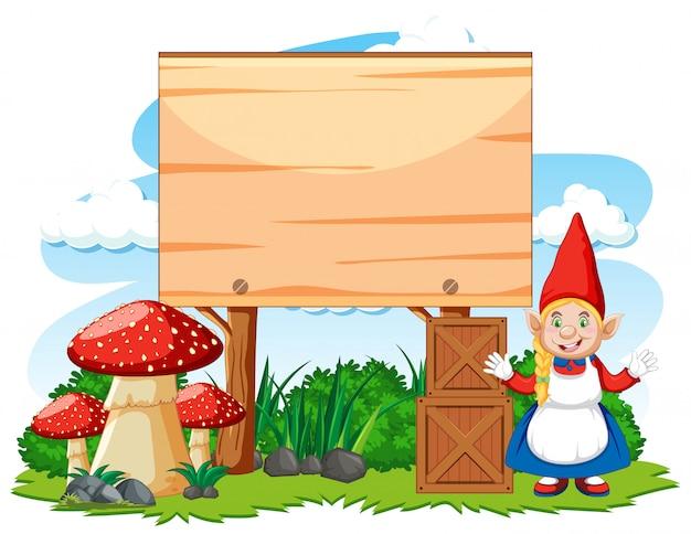 Gnome position debout à côté de la bannière vierge sur fond blanc