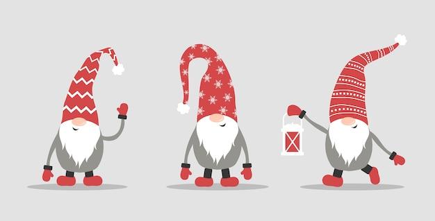 Gnomes mignons en chapeaux de père noël rouges sur fond blanc. elfes de noël scandinaves.