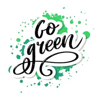 Go green creative eco concept. composition de lettrage stylo pinceau respectueux de la nature sur fond en détresse