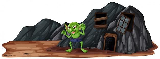 Un gobelin effrayant à côté de la grotte